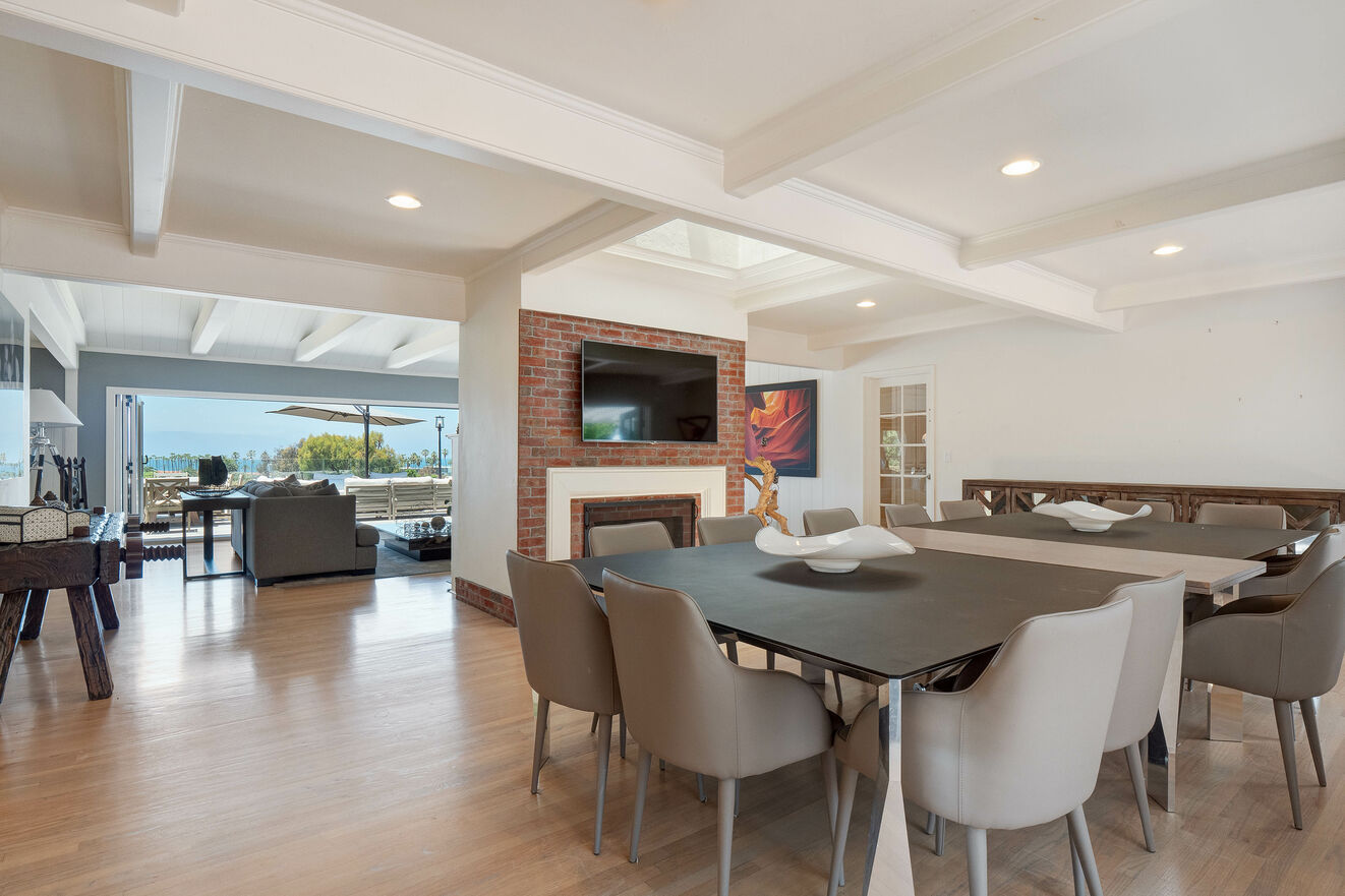 Dining room with seating for 14, fireplace and TV