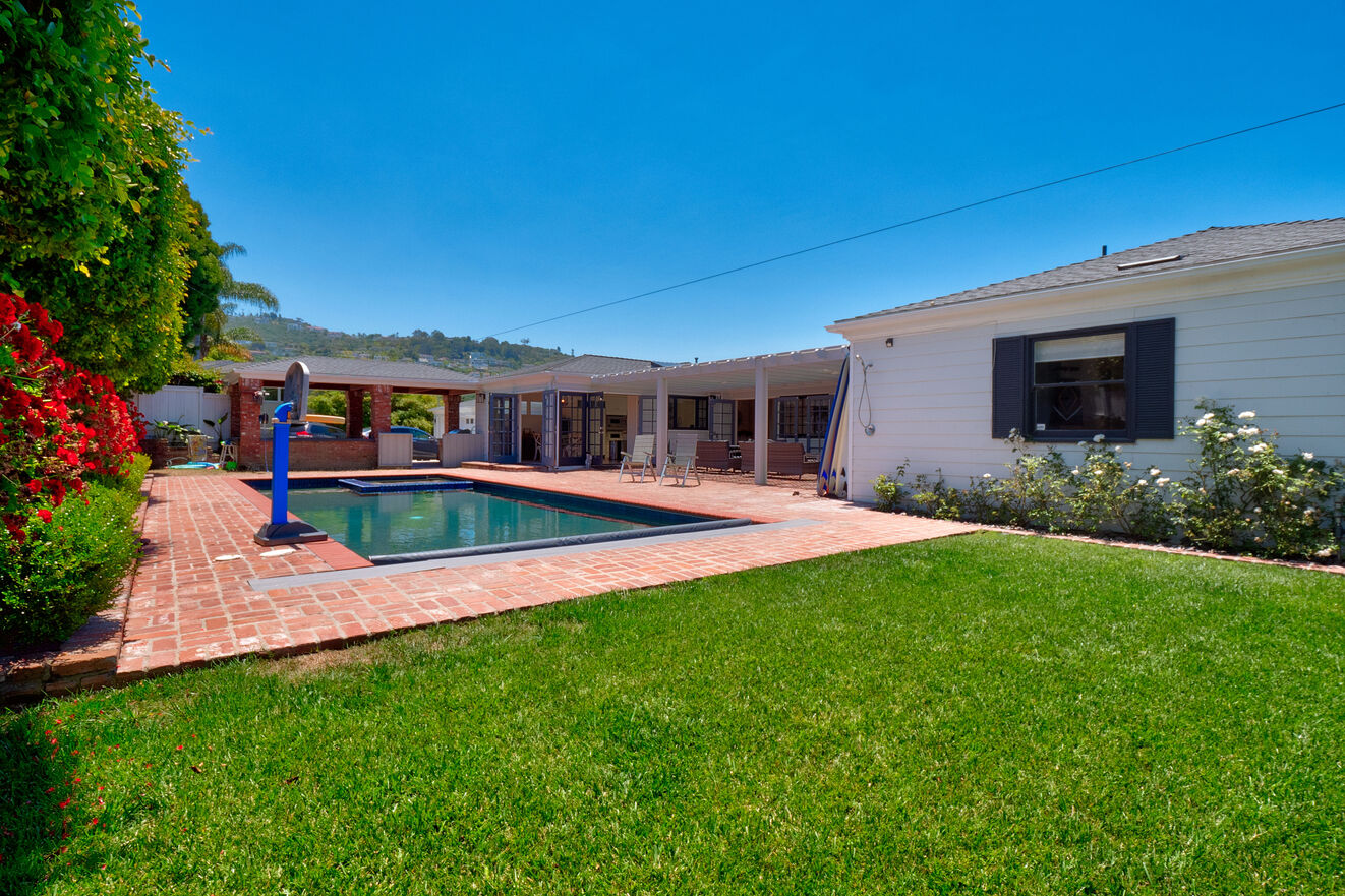 Back yard pool, outdoor kitchen and furnished patio.  Outdoor shower for use after beach.