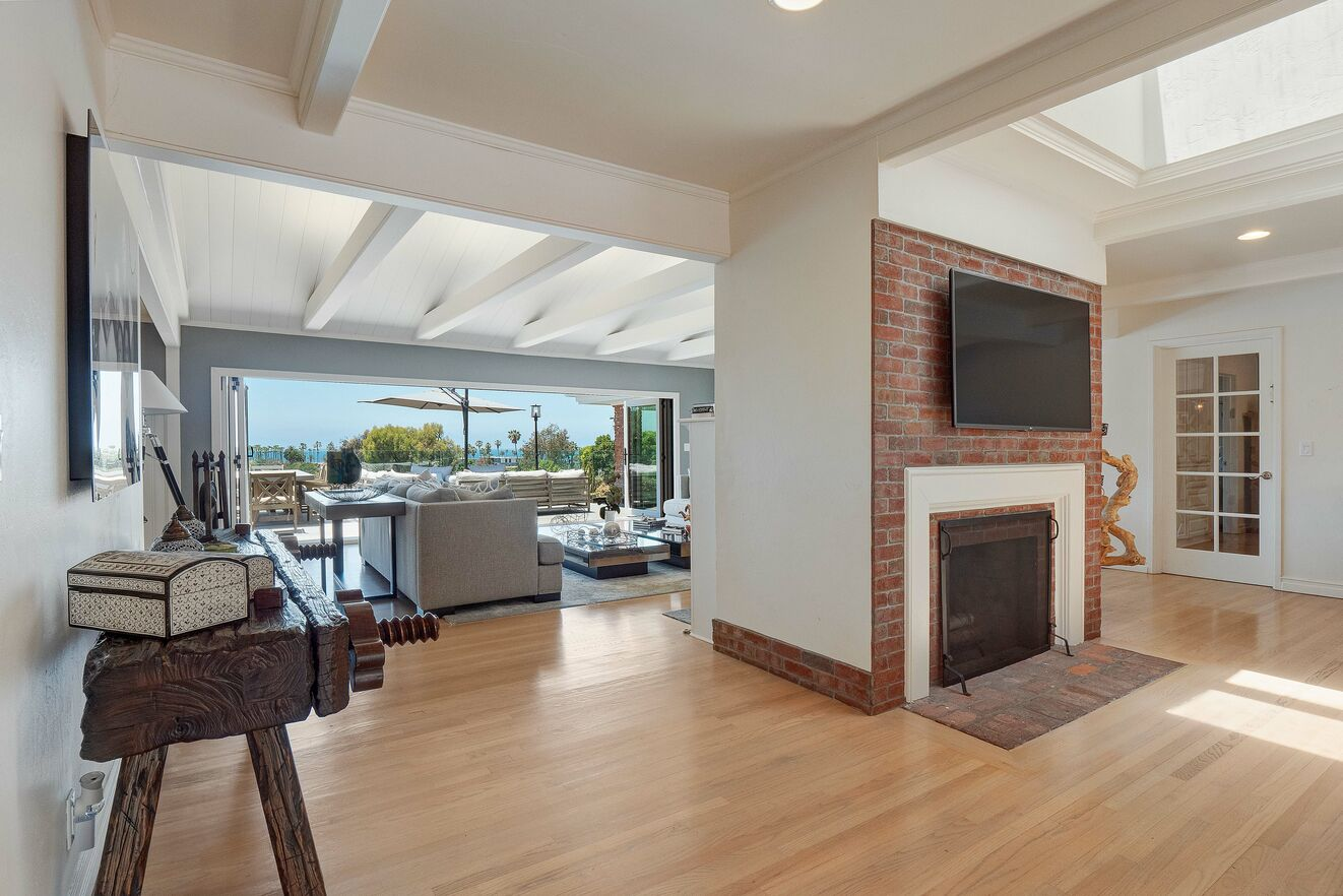 Open floor plan from living areas, deck and patio and kitchen.