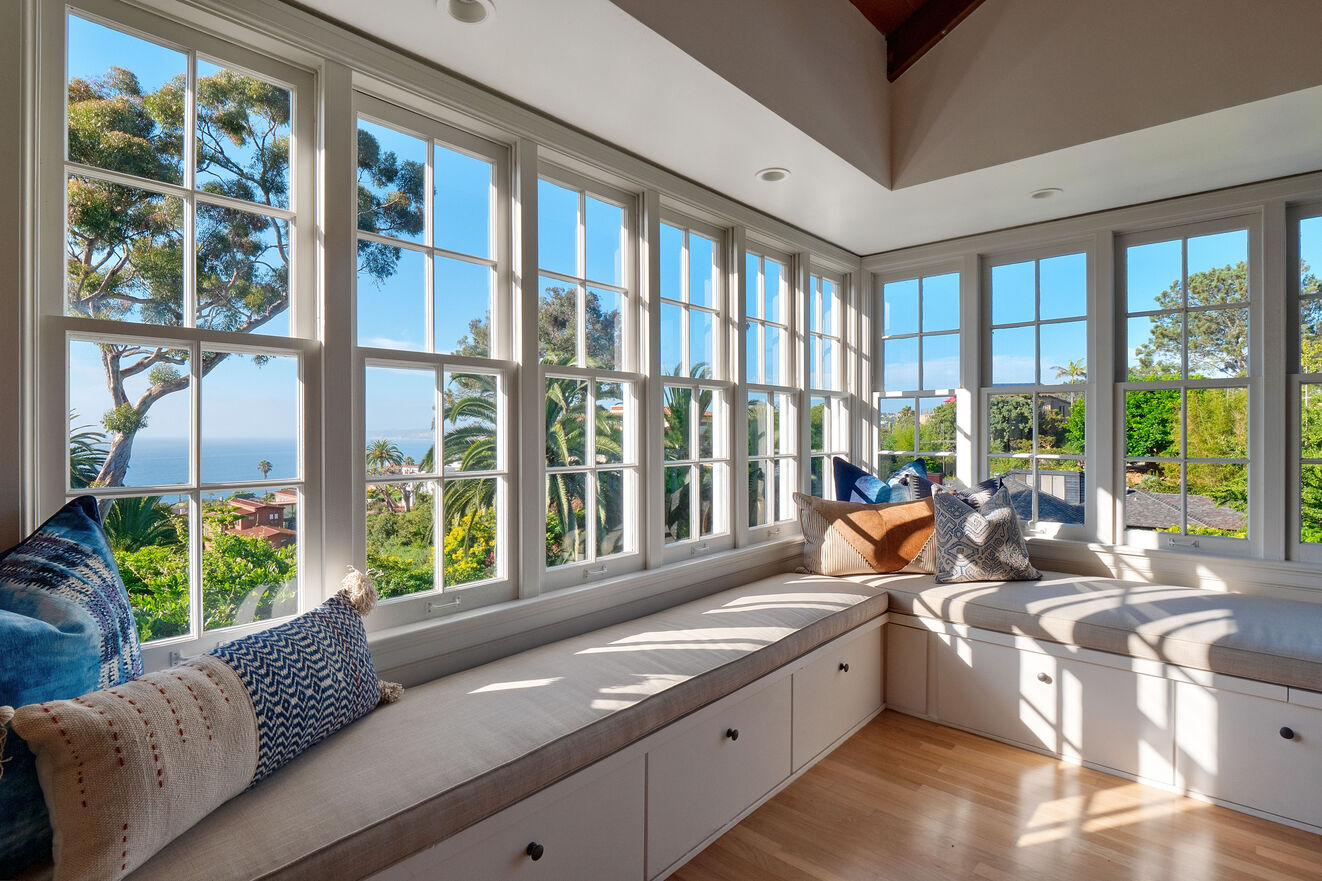 Living room with window seats and ocean view