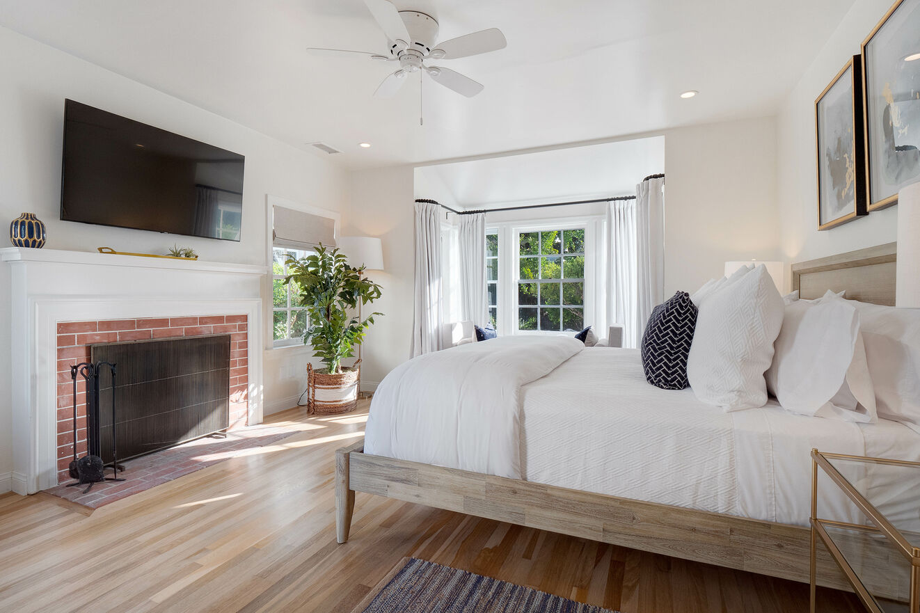 Main floor Bedroom #3 with king size bed, Jack & Jill shared bathroom, separate entrance and fireplace