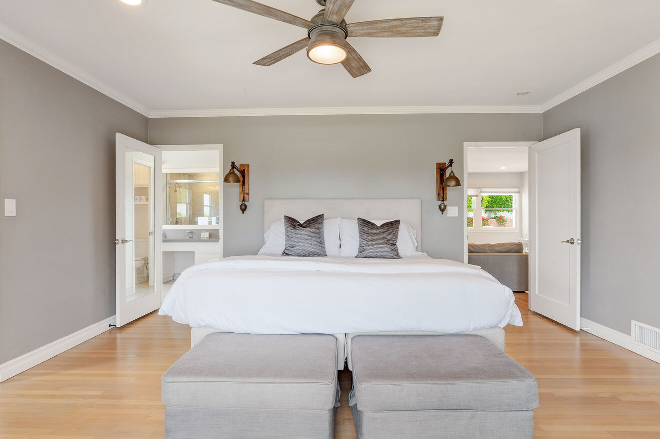 Bedroom #1 North side with King size bed, ensuite bathroom double sinks, ocean views, sitting area, huge closet area