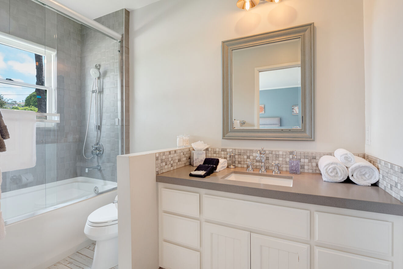 Ensuite bathroom to  Bedroom #2 with shower/tub combo