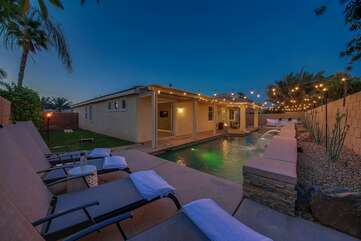 The backyard features a refreshing pool an upper deck with four lounge chairs to soak up the sun.