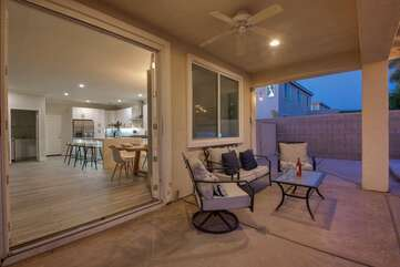 The covered patio is located outside the dinning room, which features french doors that open to the perfect backyard.