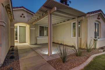 Need some fresh air? Head out front to the covered patio and enjoy the desert neighborhood.