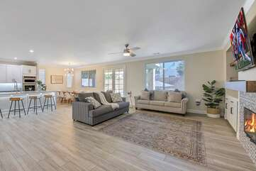 As you walk in you will be greeted by a fresh and open floor plan that connects the living space, kitchen and dinning area.