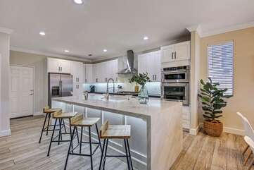 The kitchen is conveniently located next to the garage door, which makes for easy unloading if you decide to bring home take-out.