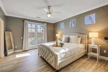 The Master Suite, located down the hall, features a king size bed, full size bathroom, plenty of room and opens directly to the backyard.