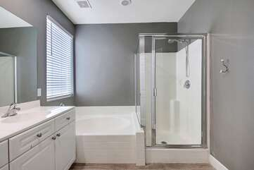 Large soaking tub and tile shower, the perfect space to get ready for a night out.