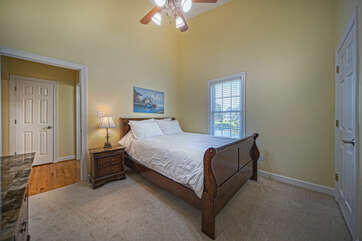 Main Level Bedroom with large bed, nightstand, and lake views.