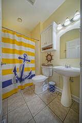 Main Level Bath with colorful nautical decor.
