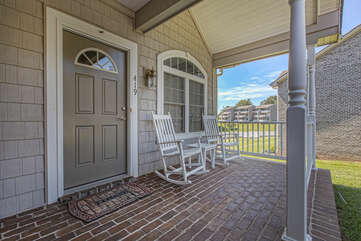 Front porch of this lakefront home  in Smith Mountain Lake with two rocking chairs.