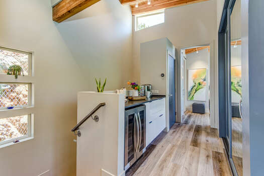 Upper Level Hallway with a Tea and Coffee Bar, Master Bedroom, and Deck Access