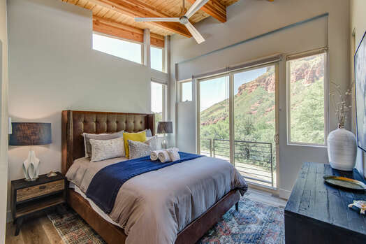 Upper Level Master Bedroom with a Queen Bed, and Plenty of Natural Light and Views