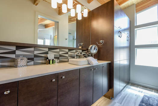 Master Bath with a Stone Counter Sink and Natural Light