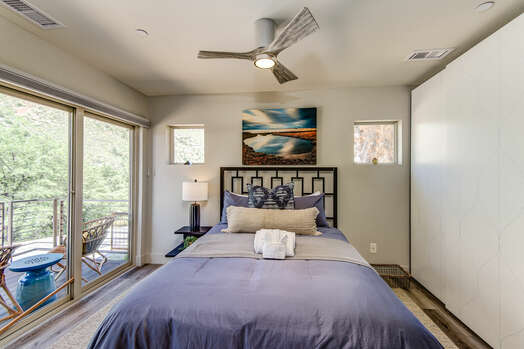 Main Level Bedroom 2 with a Queen Bed and Private Patio