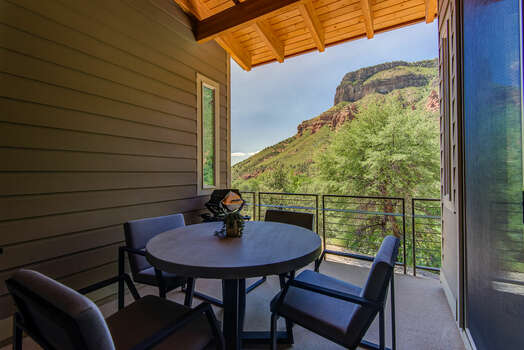 Covered Deck with Outdoor Dining and Oak Creek Mountain Views