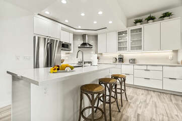 Kitchen with Island, Refrigerator, Microwave, and Coffee Maker