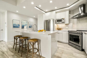 Kitchen Island with Bar Stools, Microwave, and Refrigerator
