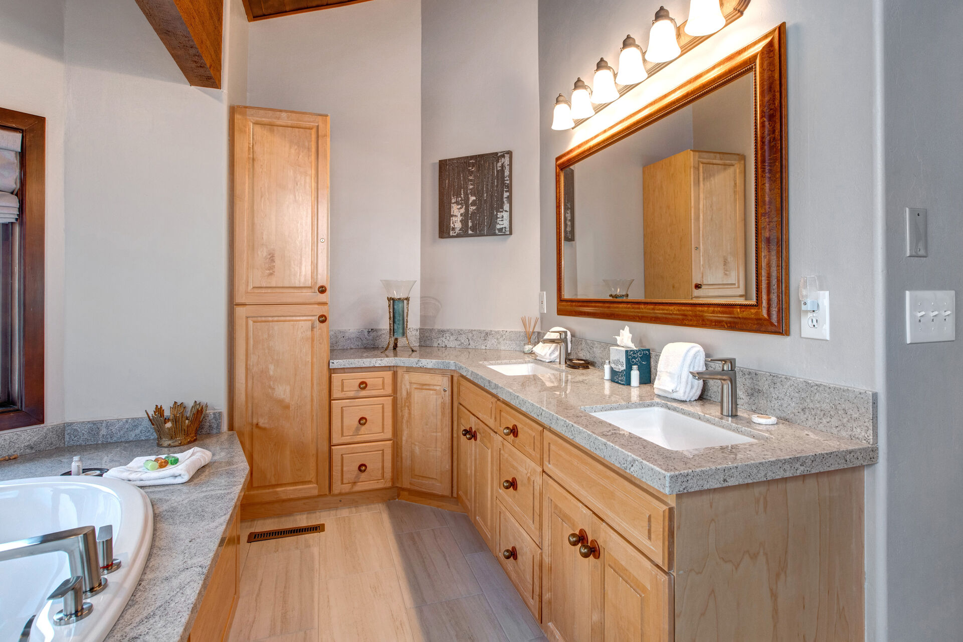 Grand Master Bath with Dual Stone Counter Sink, and a Large Soaking Tub