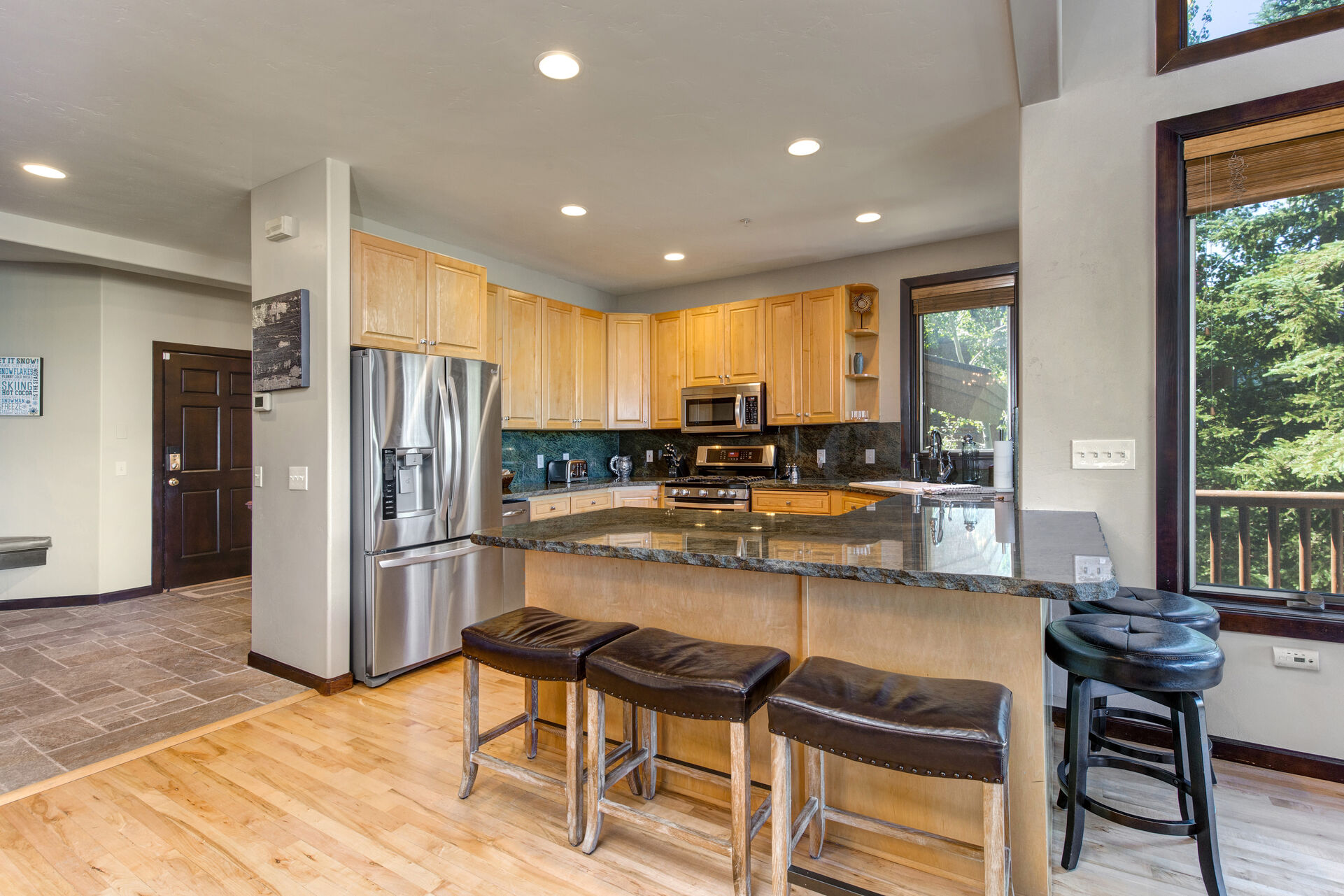 Condo Entry and Fully Equipped Kitchen
