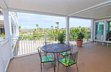 Enjoy the ocean breeze on the expansive covered deck