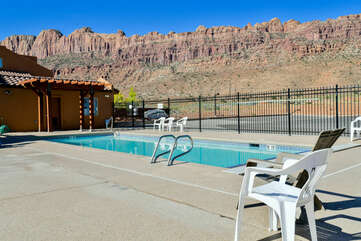 Community swimming pool with mountain views.