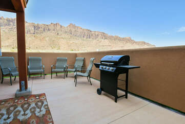 Private patio with grill and mountain views.