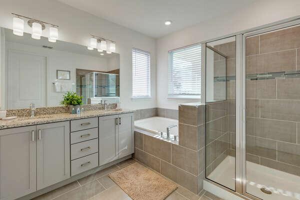 Beautiful ensuite bath has a dual vanity, walk-in shower and garden tub