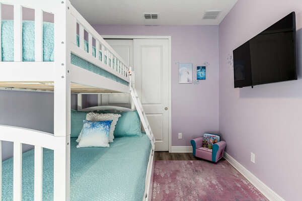 Featuring a twin over full bunkbed with a roll out trundle bed
