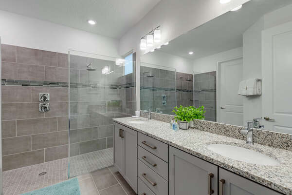 Ensuite bath with a large vanity and beautiful walk in shower