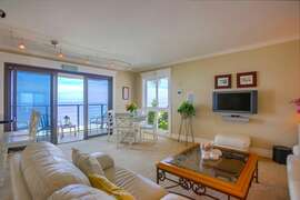 The living room has a dining area that soaks up the views and the sun!