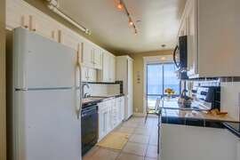 Features a galley kitchen.