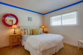 Guest bedroom also features a queen sized bed.