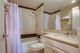 Guest bathroom with tub/shower combo.