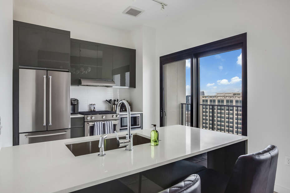 Fully Equipped Kitchen with Balcony Access