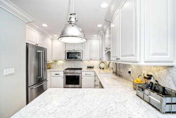Beautiful counter tops with plenty of prep space.