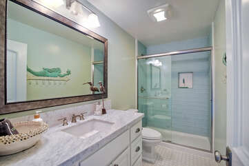 Guest bathroom with a beautiful tile shower.