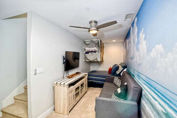 The downstairs area has a full bed with a futon and large flat screen Smart TV.