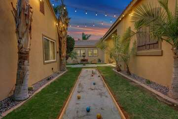 Play a little Bocce under the string lights.
