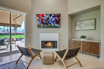 Finished with your meal and still want to hang out? Move over to to the lounge area which features two chairs, a fireplace and a 65-inch Samsung HDTV.