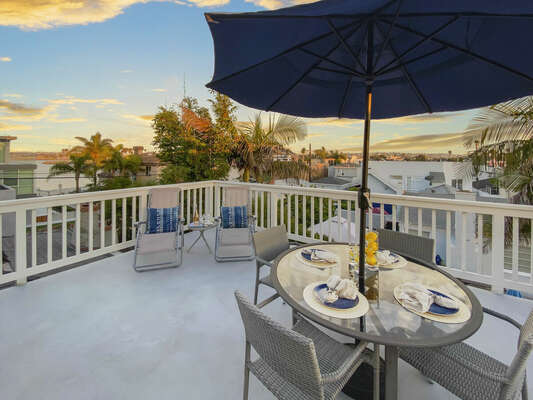 Spacious Patio with Outdoor Dining, Lounge Chairs and Bay Views - Third Floor