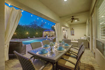 Enjoy your meals in the fresh air at the patio dinning table with room for six.