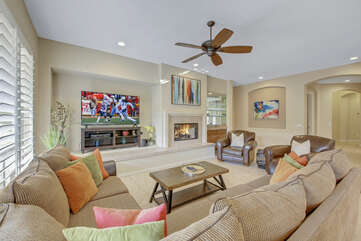 Room for the whole family on the oversized couch, enjoy the roaring fireplace in comfort.