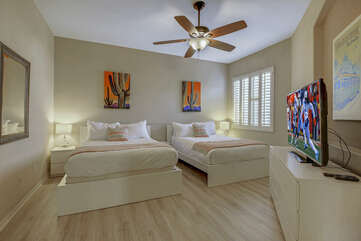 Bedroom 6 is located next to the living room and features two Queen-sized Beds and a 55-inch Samsung Smart television.