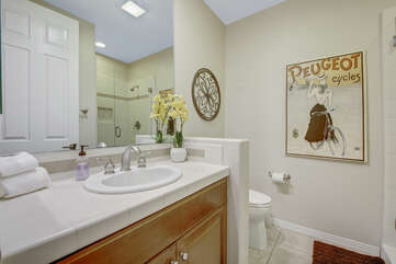 The hallway bathroom is located at the end of the hallway and features a tile shower.