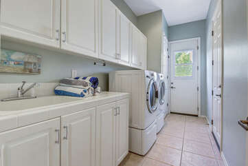 Fully equipped laundry room with washer, dryer, ironing board, Vacay Stay provides Tide Pods so you can wash your clothes before you head home.