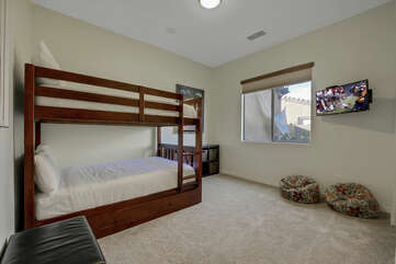Bedroom 5 is located next to the laundry room and features a Full Over Full Bunk Bed, and a 32-inch Samsung HDTV television with Roku.