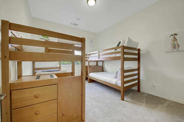Bedroom 6 is located across from the hallway bathroom and features 2 Twin Over Twin Bunk Beds and a 42-inch Panasonic HDTV television with Roku.